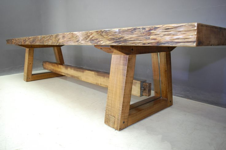 A fusion of old and new - Pierre Cronje Houghton Dining Table made from Yellowwood -  with waney edge top and base with glass panels.