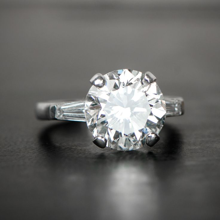 A beautiful estate diamond engagement ring, sporting a 5 carat diamond.