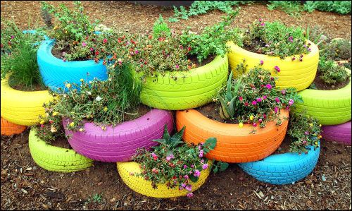 "Another Pinner wrote: ""I completed this and combined it with the tractor tire pond. I placed these planters behind the pond like a wall."""