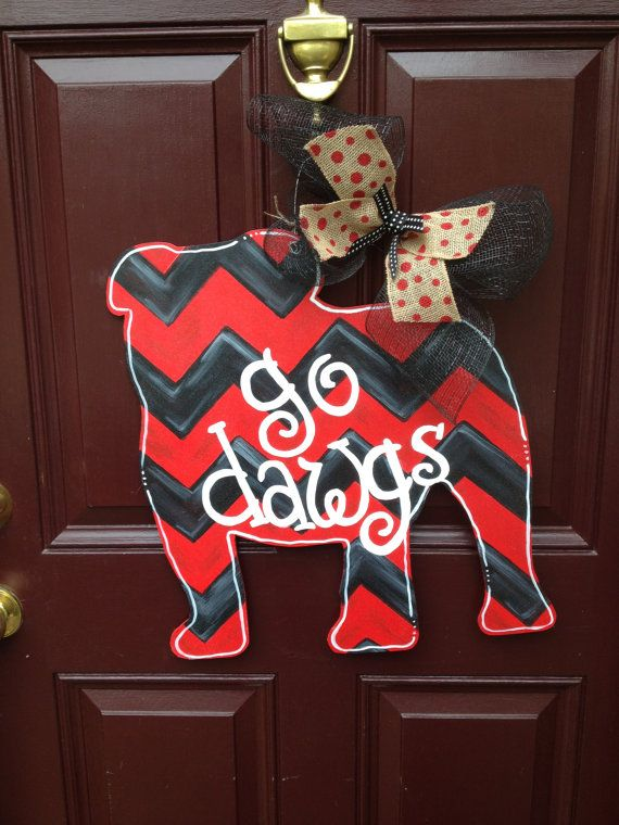 Show your SEC school pride or decorate his man cave with this Georgia Bulldog Door Hanger. Made of 1/4 sanded plywood and hand painted with a