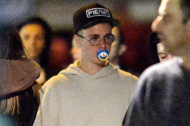 if you're having a bad day, here's justin bieber sucking on a pacifier to quit smoking.