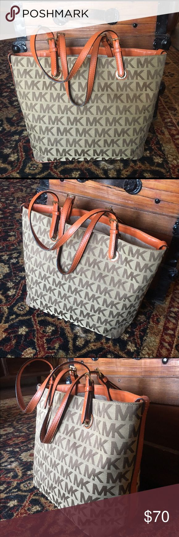 Grey & Orange MK monogram Tote Gently used Michael Kors purse. Bought from TJ Maxx. A few unnoticeable stains on the inside of the bottom of the purse, but overall condition is great. Michael Kors Bags Totes