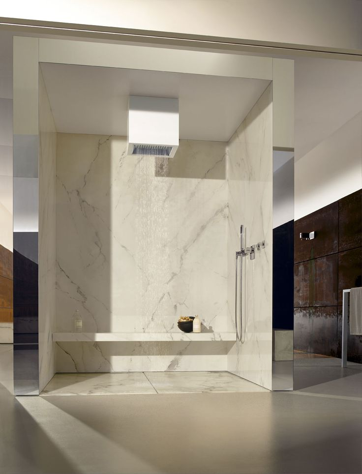 Elegant Stylish rain shower with ceiling connection and hand shower by Dornbracht Elemental Spa Collection