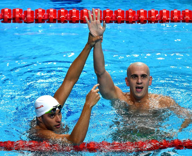 Gold medalist Chad Le Clos of South Africa and silver medalist Laszlo Cseh of Hungary celebrate following the Men's 200m Butterfly final on day thirteen of the Budapest 2017 FINA World Championships on July 26, 2017 in Budapest, Hungary.