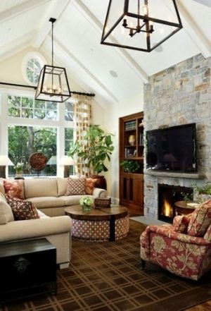 love that fireplace and the beamed cathedral ceiling