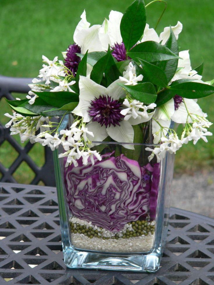 Clematis florida 'Sieboldii', star jasmine, red cabbage, dried mung beans, rice. Floral arrangement idea