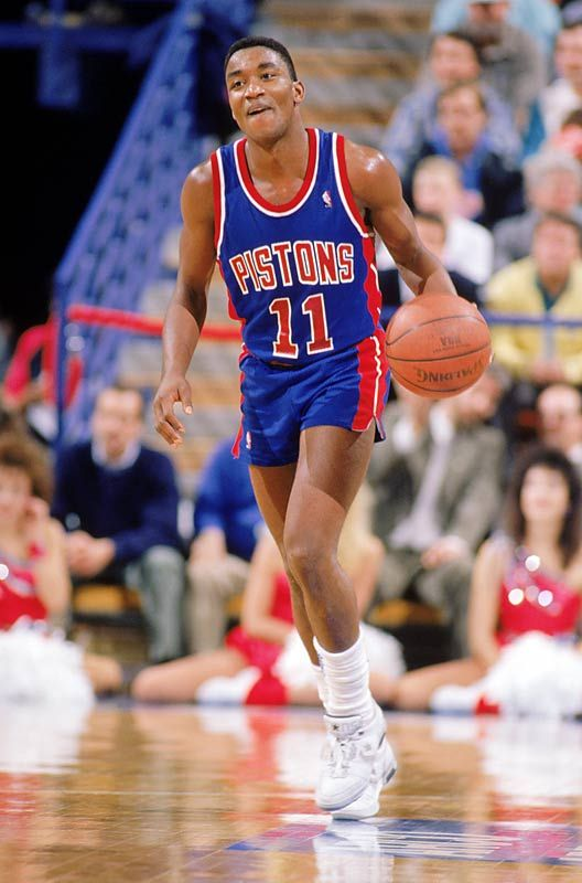 "Isiah ""Zeke"" Thomas was one of the greatest ""small men"" ever to play professional basketball. His only peer at point guard in the NBA during the 1980s was the Lakers ""Magic"" Johnson, who at 6-9 brought unique physical skills to the position. Thomas, who stood barely over 6-feet, was in his day the grittiest performer to play the position, a feisty competitor who offered no quarter and expected none in return. Like Johnson, Thomas possessed the skill and determination to take over a game at…"