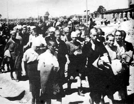 Female prisoners in Birkenau marched to forced labor at the IG Farben chemical factory