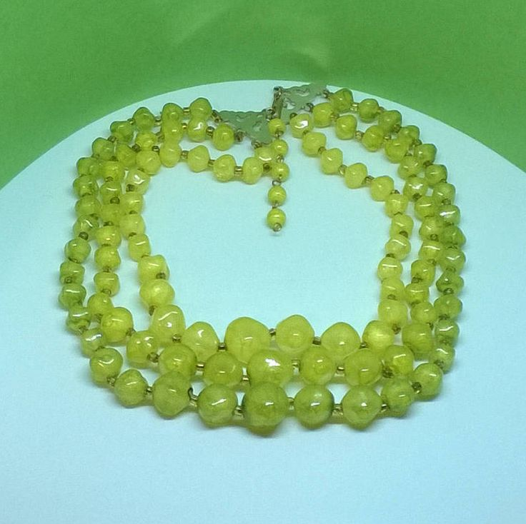 Triple strand necklace of graduated green faceted plastic beads. by ThePemburyEmporium on Etsy
