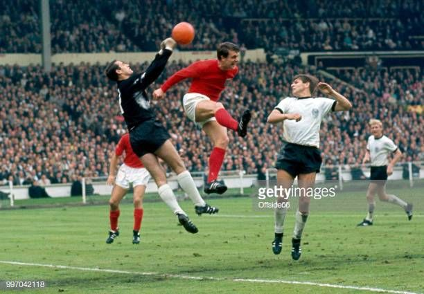 Goalkeeper Hans Tilkowski Of West Germany Punches Clear From Geoff