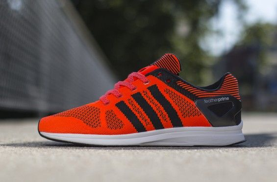 """adidas Adizero Feather Primeknit – """"Solar Red/Black""""- http://getmybuzzup.com/wp-content/uploads/2014/07/337441-thumb.jpg- http://getmybuzzup.com/adidas-adizero-feather/- By Renz Ofiaza An answer to Nike's lineup of flyknit silhouettes, the adidas adizero Feather Primeknit offers up a slim profile that is both snug on the foot and airy. Finished in a standout solar red/black colorway, the lightweight runner features a fully woven upper to ensure maximum...- #Adidas"""