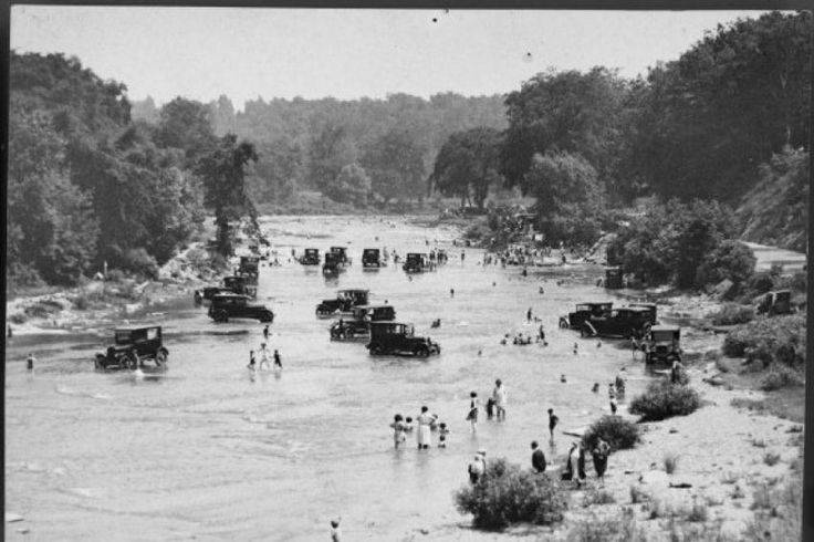 Washing cars in the Humber river in 1922. While that doesn't happen today, there is a delicate debate between encouraging access to ravines and ensuring their ecological health.