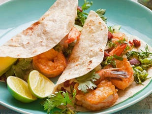 Soft Tortillas with prawns and lime herb salsa    Take a trip down Mexico way with fast, fresh, flavoursome food. This lip-smacking salsa is addictive – you could also serve it on a platter topped with barbecued chicken skewers. Yum