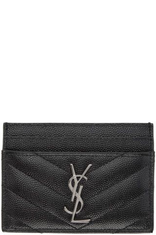 Quilted 'grain de poudre' calfskin card holder in black. Logo plaque at face. Card slots. Tonal leather lining. Silver-tone hardware. Tonal stitching. Approx. 4.25 length x 3 height.