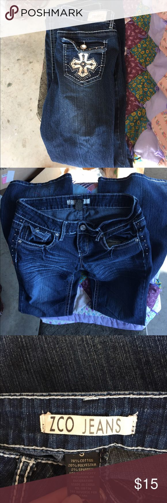 ZCO Jeans Practically brand new ZCO jeans with designs on back pockets. Excellent condition, maybe worn twice. They are too big for me now. ZCO Jeans Boot Cut