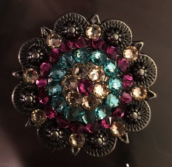 Conchos for western horse tack in fuschia teal and gold