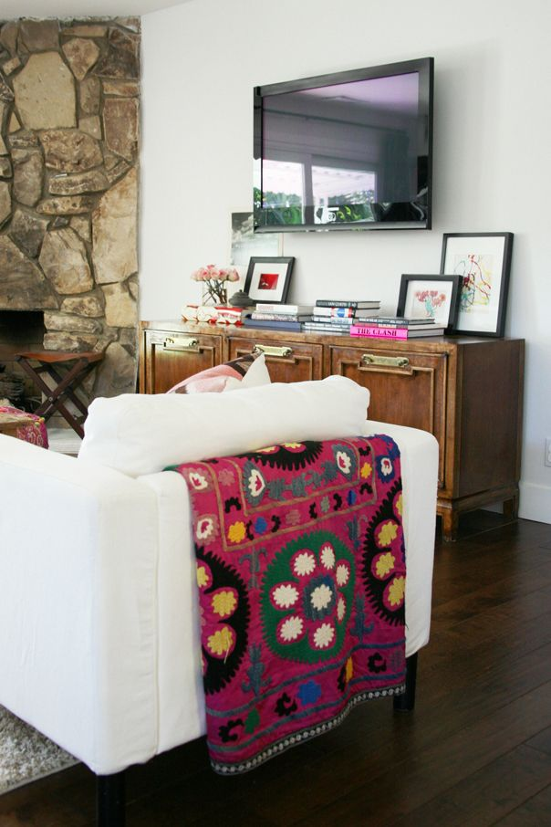 Love the blanket and the console.  Do you think it hides all the stuff that is usually under a TV?