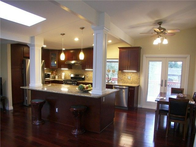 Kitchen wall removed in split level home.  Columns and french doors. mid entry / split level - Picmia