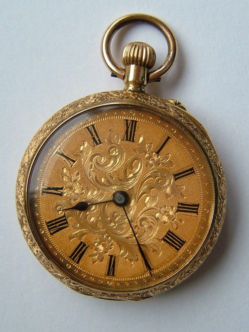 Men's gold pocket watch from 1890.  Add a sapphire button, and this watch resembles the one mentioned in Whispers in the Reading Room by Shelley Gray.