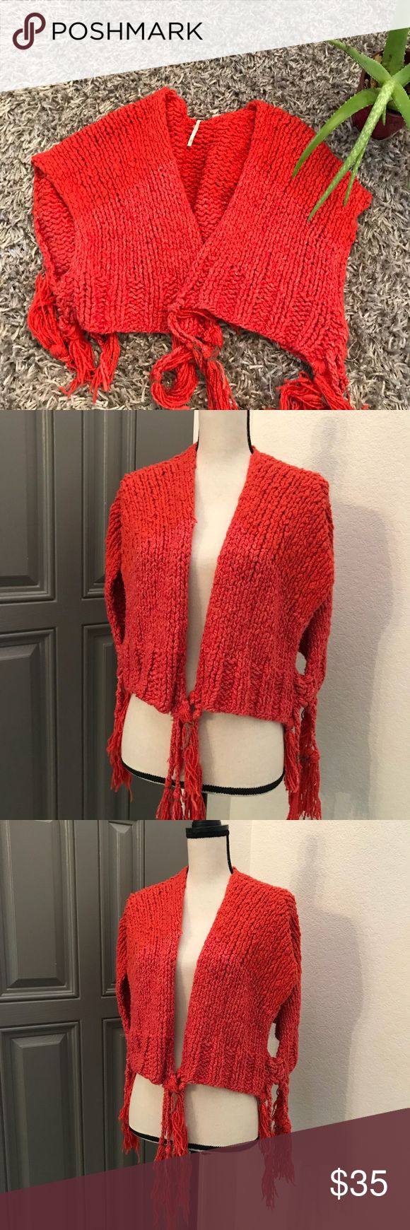 """Free People Cozy Sweater Fringed Vest Chunky Knit 1️⃣5️⃣ Women's large  Orange (burnt) color  Awesome fringed tassels  Gently worn  Length is 16"""" Width varied with how you Wear it but laying flat about 27"""" Free People Sweaters Shrugs & Ponchos"""