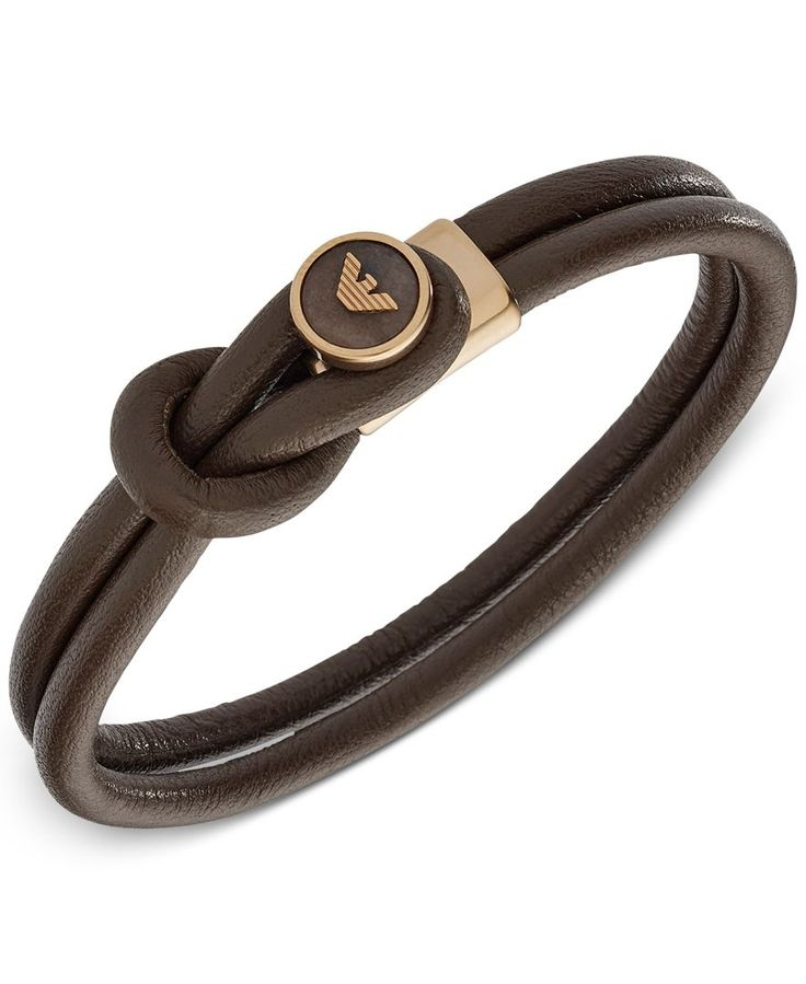 """Dual bands of smooth brown leather create a toggle fastener for a logo-engraved button in Emporio Armani's sleek bracelet. Designed in gold-tone mixed metal. Approximate diameter: 2-1/4"""". 
