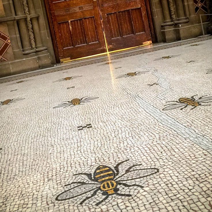 MANCHESTER TOWN HALL BEES: Originally laid out by Venetian craftsmen, the 4,500 yards of beautiful marble flooring in the building primarily feature cotton flowers along its length. But here, 67 bees are laid out in an overhead design.