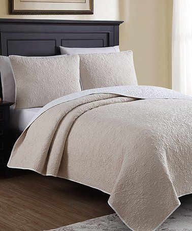 This Oatmeal  Off-White Marseille Quilt Set is perfect