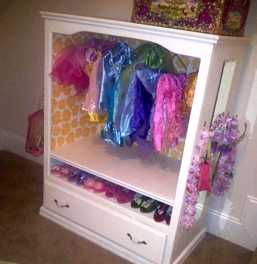 Dress-up closet lined in Singular Blooms wrapping paper
