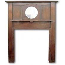 Edwardian oak mantel with circular mirror