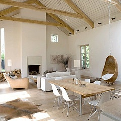 gorgeous contemporary loft/barn conversion living . wooden white ceiling . fireplace . neutral colors . window grey/ beige . lamps .