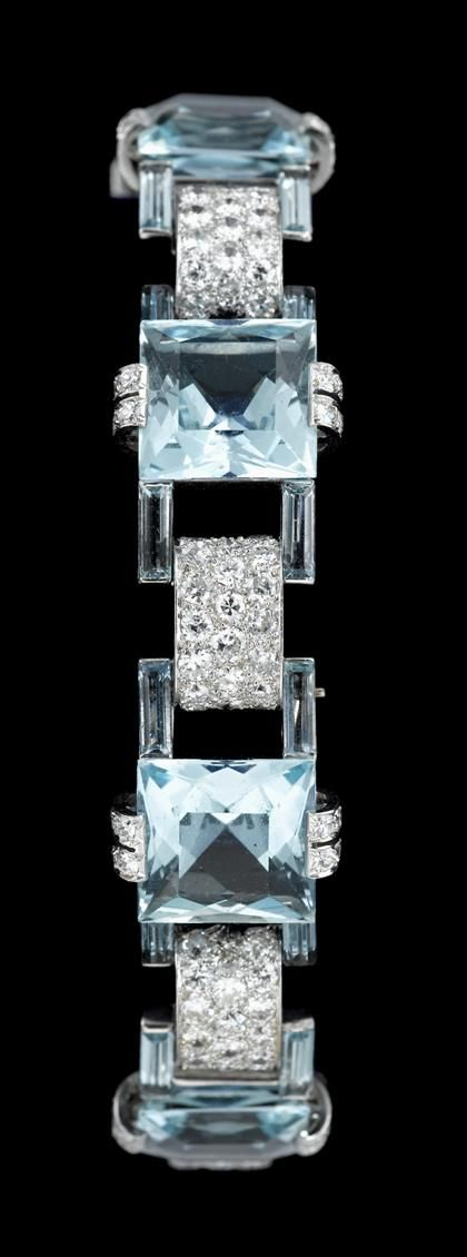 18 karat white gold diamond and aquamarine dinner bracelet   mid 20th century   Six square cut aquamarines separated by convex pave set diamond links in the Art Deco style.