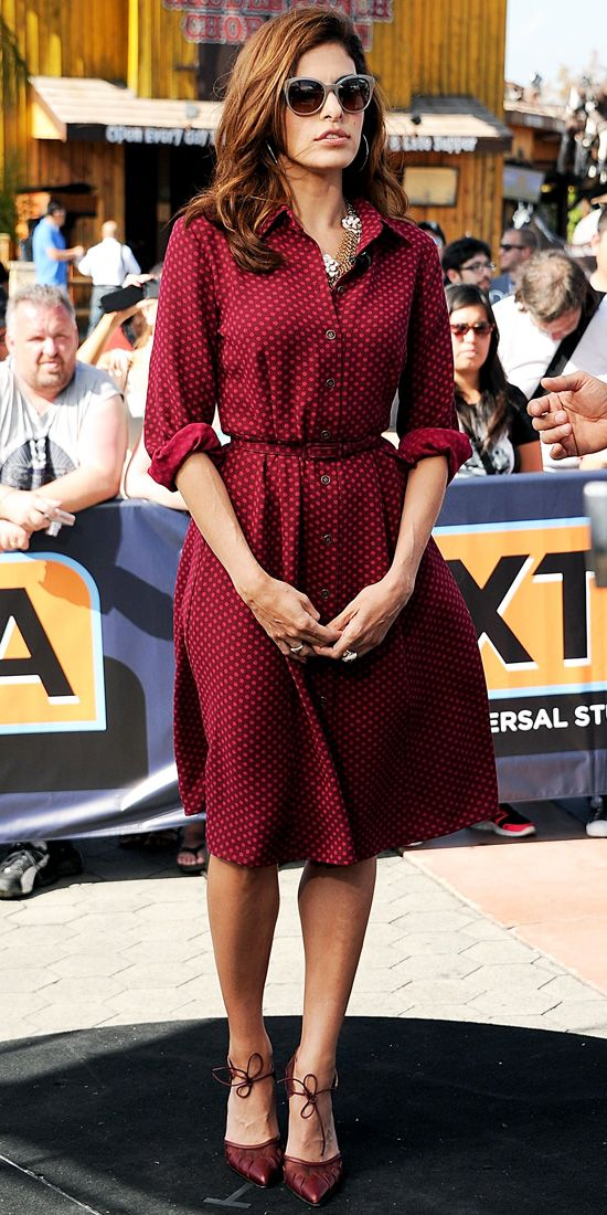 EVA MENDES Mendes coordinated her polka-dot shirt dress (from her collection with New York & Company) with a rose adorned gold-chain necklac...