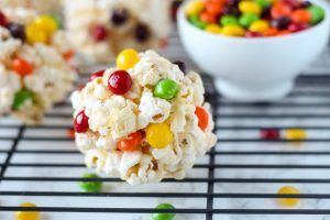 Amazingly easy 4-ingredient popcorn balls made with kettle corn and skittles! Kids will love these Rainbow Kettle Corn Popcorn Balls