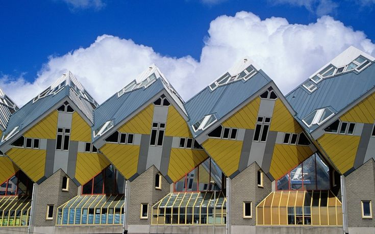 Cubic houses, Rotterdam, Holland    Kubuswoningen, or cube houses are the brainchild of architect Piet Bloom. Tilted at 45 degrees on a hexagon-shaped pylon, Bloom wanted to create some space in an area of high-density housing.
