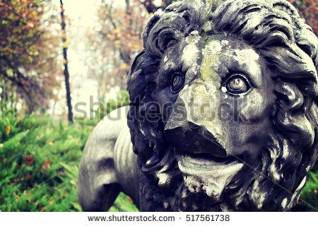Park Lion with broken face