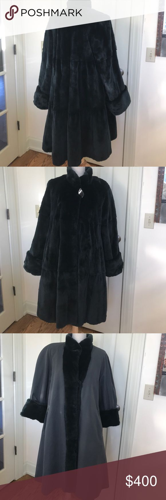 Beautiful reversible fur and raincoat, Beautiful, reversible fur and rain swing coat.  I say is has a slight green/blue/black color.  Not sure of the size, but I'm a small and wear it, but definitely will fit a large size.  It has shaved fur, and is extremely soft. The only place a see some wear to the fur is the front button closure area.  See last pic. Jackets & Coats