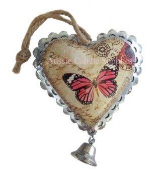 Antique Pink Butterfly Heart $1.50