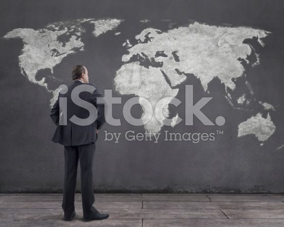 Businessman and World Map Painting on the Wall (royalty-free stock photo) © mgkaya