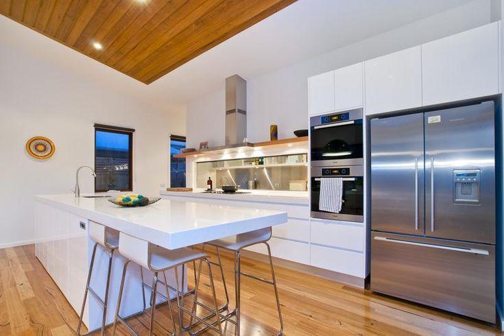 White modern kitchen, recycled Tassie Oak timber floor, Duncan Pascoe Builders