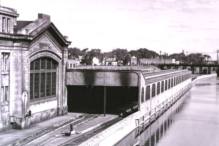 """here is a """"zoom-in"""" of the train sheds at Ottawa's Union Station in Novermber of 1940.   No Mackenzie King Bridge in those days, so you can see all the way to Laurier Ave, where the big Imperial station catches my eye (attention Laurie Catherine!).   That building to the right of the service station was a LCBO warehouse, I think someone said."""