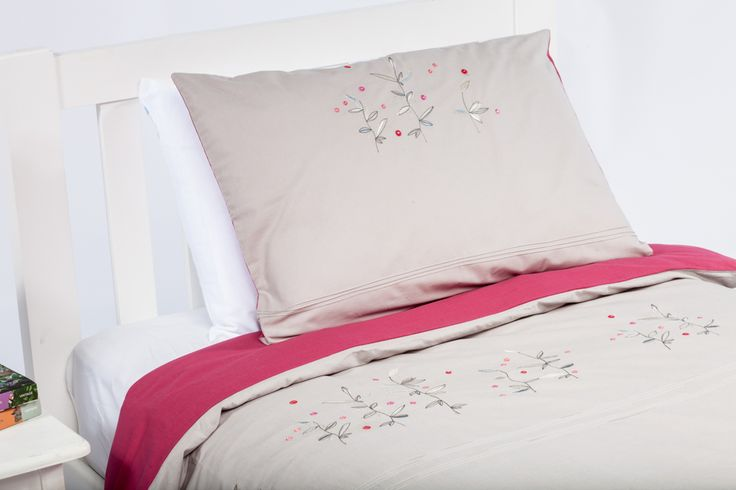 This gorgeous French designed quilt cover features embroidered flowers and raspberry hues on taupe.