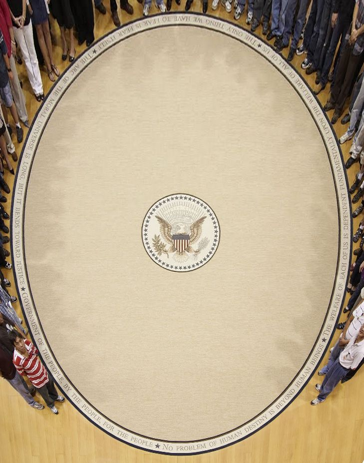 President Obama's Oval Office rug: wheat colored, very simple and plain, with five quotes around the outside edge.