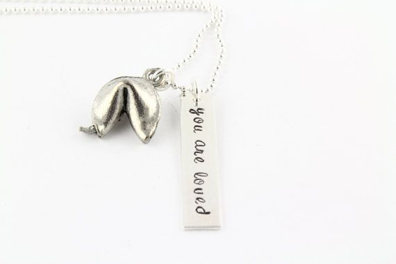 Hey, I found this really awesome Etsy listing at http://www.etsy.com/listing/129707903/personalized-fortune-cookie-necklace