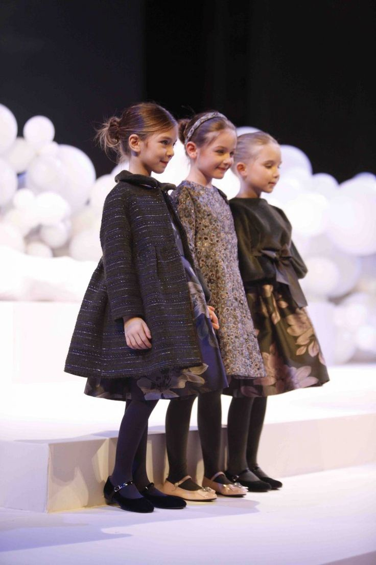 Coats had a fit and flare silhouette at Il Gufo kidswear for fall/winter 2017