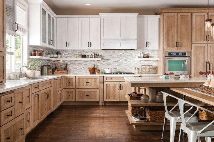 Shown in Dalton quartersawn oak Cottage White Sheer with quartersawn oak Cappuccino base cabinets