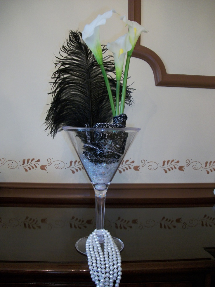 An oversized martini glass confettie black ostrich
