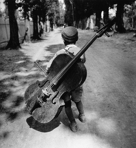 Éva Besnyő, Gypsy Boy with Cello on ArtStack #eva-besnyo #art