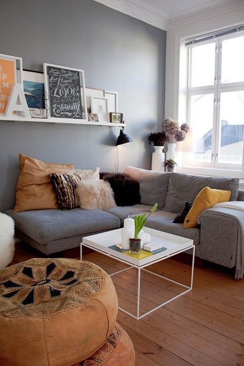 Grey . . . simple, sophisticated and so much in fashion. An uncomplicated and comfortable living room in the coolest of colours accented by white and shades of ochre, honey and chocolate.