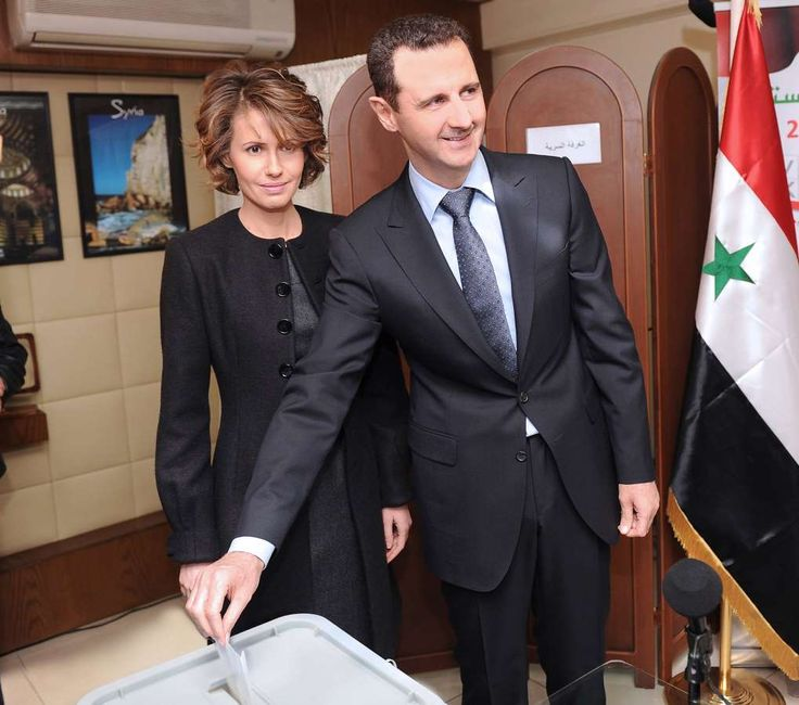 SYRIA - Syria's civil war has been raging for 7 years. What's behind it? - February 21, 2018.  Syrian President Bashar al-Assad votes next to his wife, Asma, in 2012.
