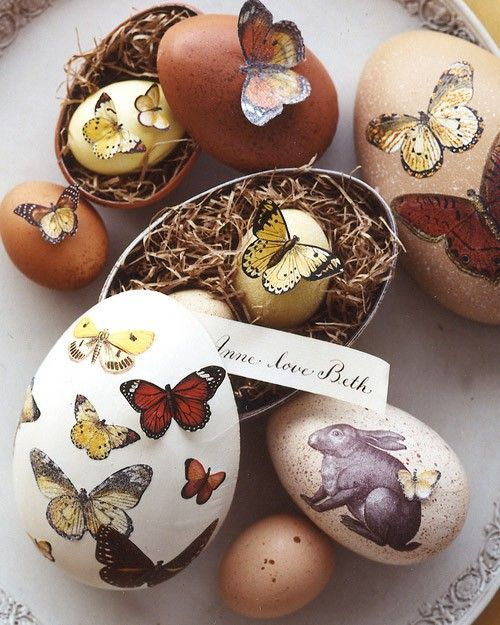 Give egg-shaped boxes a natural touch with speckled paint, butterflies, and a rabbit cut from decorative paper.